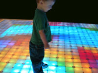 Kid on lighted LED dance floor